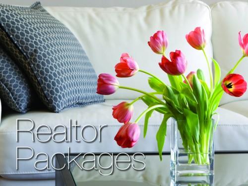vase of red tulips in modern white living room - home decor